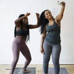 Women taking selfies on yoga mat